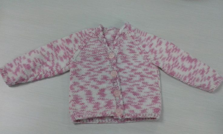 My new favourite basic baby cardigan pattern. Sirdar cardigan Design 1419 from the Baby Vintage by Snugly book (434)but without the pattern, and with a scalloped neck border for Little Sprouts