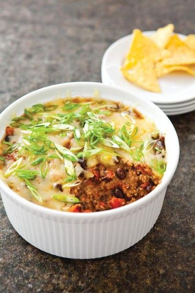 A Taco Dip Touchdown  -  hamburger, ground beef, veggies, beans, tomatoes, spices, cheese, nachos.  use our own spice mix to lower sodium, watch beans, adjust prn to lower carbs.        lj