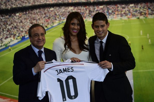 Real Madrid's President Florentino Perez (L), Colombian striker formerly at AS Monaco James Rodriguez (R) and his wife Daniela Ospina pose during his presentation at the Santiago Bernabeu stadium following his signing with Spanish club Real Madrid in Madrid on July 22, 2014. Spanish media said Real paid about 80 million ($108m) for Rodriguez, making him one of the most expensive players ever. Neither club gave a figure, but Monaco said it was 'one of the biggest transfers in football…