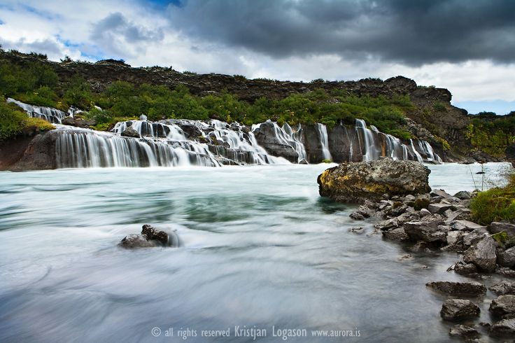 Hraunfossar waterfalls in Hvítá in West Iceland  Hraunfossar (Borgarfjörður, western Iceland) is a series of waterfalls formed b...