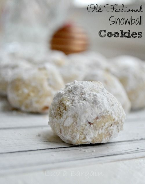 A holiday favorite! These Old Fashioned Snowball Cookies are a must to add to your Christmas cookie list.  Making these Old Fashioned Snowball Cookies is truly one of my fondest memories of my childhood Christmas traditions. I made these cookies with my mother each year and I felt like such a big girl rolling the dough into little balls with her.  I am loving carrying on the tradition with my daug...