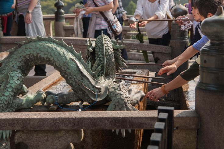People washing their hands in a dragon fountain at the Kiyomizudera temple in Kyoto, Japan. This photo is published under Creative Commons Attribution-NonCommercial 3.0 license. Photo by Sami Hurmerinta / Explodingfish.net. #wanderlust #travel #kyoto #japan