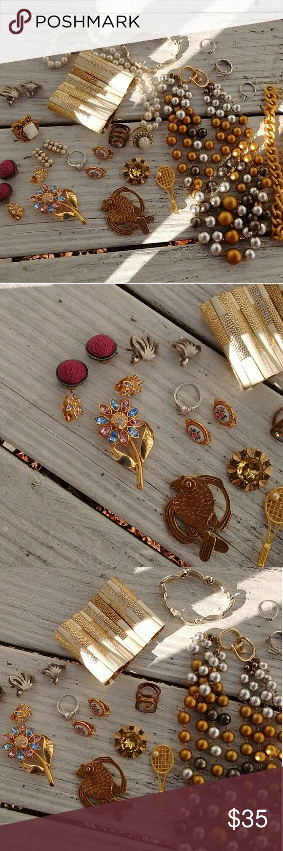 Huge Costume Jewelry Bundle Lot 21 pieces *Total of 21 jewelry pieces: 7 rings, 5 pairs of clip-on earrings, 4 pin brooches, 2 bracelets, and 3 necklaces  *Gold colored and silver colored costume jewelry bundle  *Rings, bracelets, necklace, clip-on earrings and brooch lot  *Unsigned, Kramer, Avon, and Hong Kong  *pre-loved wear, various wear, some may need cleaning Jewelry