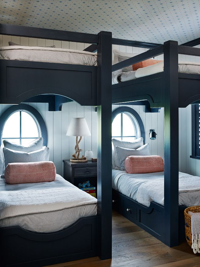 Navy Bunksets with Oval Windows l Coastal Bedrooms & Baths l www.DreamBuildersOBX.com