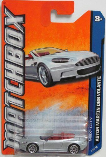 """Matchbox 2012 City Collection 3 of 10 Collector # 23 of 120 Silver Aston Martin DBS Volante 2012 23 by Mattel. $2.95. # 23 of 120 Vehicles from the 2012 Matchbox line. # 3 of 10 Vehicles in the 2012 """"MBX City"""" Collection. 2012 Matchbox Aston Martin DBS Volante in silver. Red interior."""