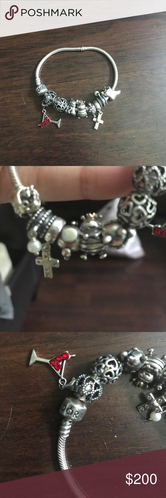Preowned, like new pandora bracelet Like new pandora sterling silver bracelet with assorted charms: martini glass, heart, queen bee, teapot, cross, pearl, cat and Christmas stocking beads Pandora Jewelry Bracelets