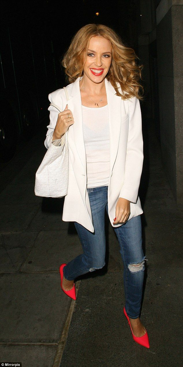 The red shoes: Kylie Minogue leaves The O2 in some very vibrant heels on Wednesday night