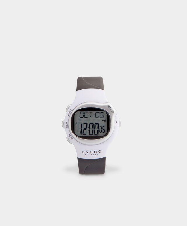 Reloj deportivo, 22.99€ - Reloj deportivo gris y blanco. Cuenta con cronómetro, alarma, cuenta-calorías, indicador del ritmo cardíaco. Garantía de 2 años. - Encuentra más tendencias primavera verano 2017 en Oysho.