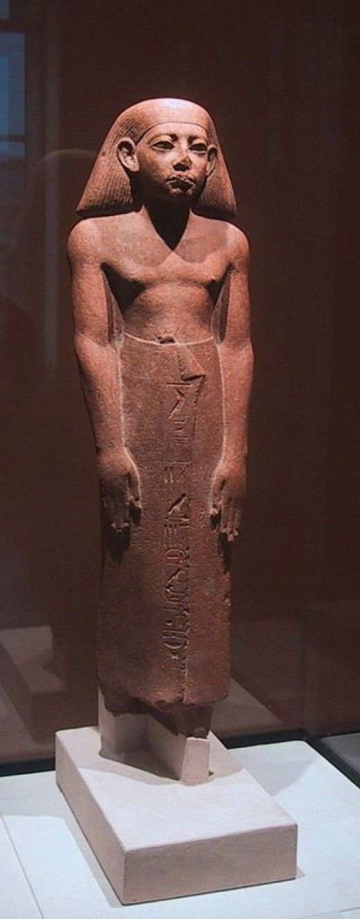 """The hieroglyphs carved on the front of the skirt of the statue and on the back pillar tell us that Amenemhat-ankh, whose name signifies """"King Amenemhat lives' was Keeper of the Secrets of (the god) Ptah-Sokarat Memphis and Chief Prophet of Shedet under Amenemhat III (1842-1797 B.C.). S"""