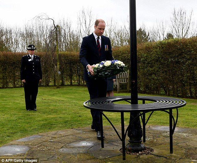Tribute: The Duke of Cambridge lays a wreath at at the Police memorial, a blue police lamp taken from Hitchin police station in Hertfordshire, with a note to fallen PC Keith Palmer
