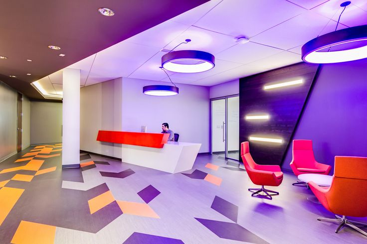 The Happy Highback lounge chairs give this Risk Analytics space in Kansas City a beautiful pop of color while offering a comfortable lounge sit in their lobby.