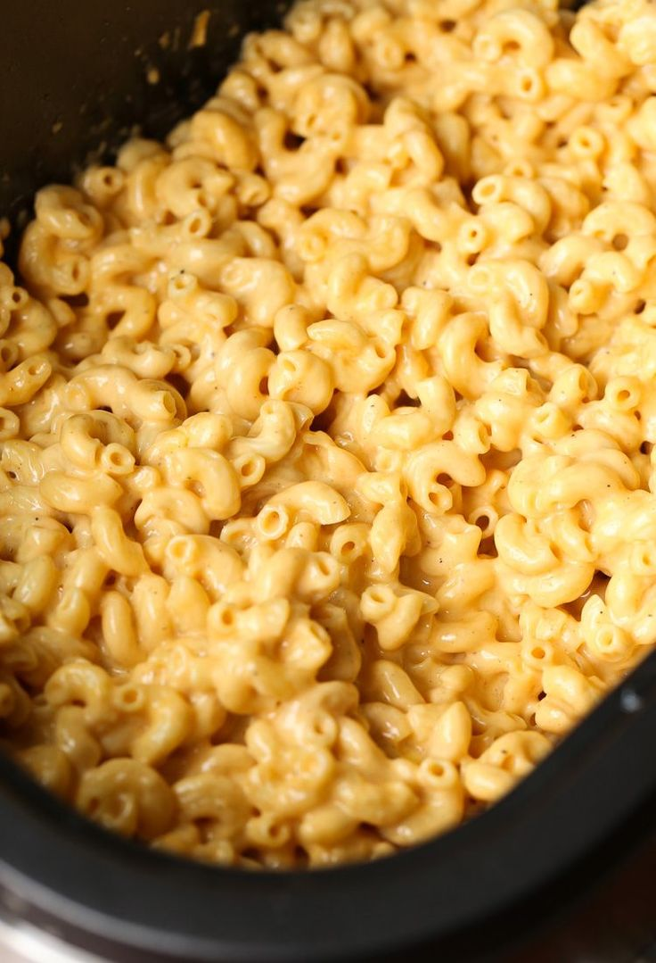 No need to boil your pasta before making this EASY Crock Pot Mac and Cheese! Super creamy and done in just a few hours!