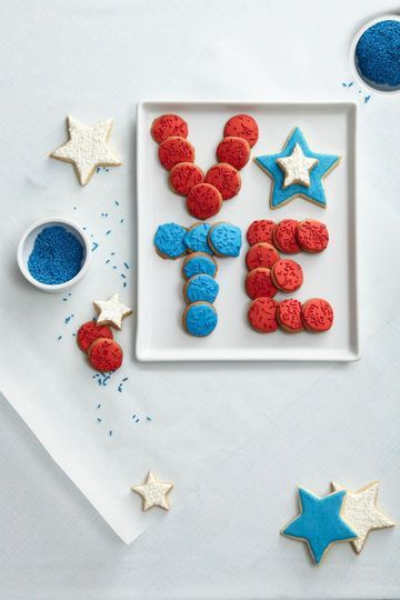 This patriotic cookie platter is perfect for an Election Day bake sale or as a thank-you to polling volunteers!  Start with a box of Nilla wafers—or any small cookie—and decorate them with red and blue icing and sprinkles. We used a simple royal icing: Mix 1 cup confectioners' sugar with 2 Tbs. whole milk. Whisk until your consistency is similar to craft glue, adding up to 2 Tbs. more milk half a tablespoon at a time, as needed. Add red or blue food coloring. Bake a lar...