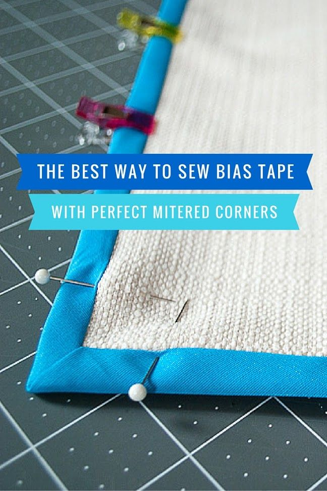 Here's the best and easiest way to sew bias tape with mitered corners. Includes detailed step-by-step photos plus a video! Try this easy method and you'll sew pretty, perfect mitered corners with double fold bias tape.