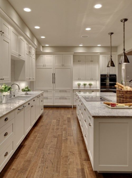 natural wood floors, white cabinets, white marble countertop