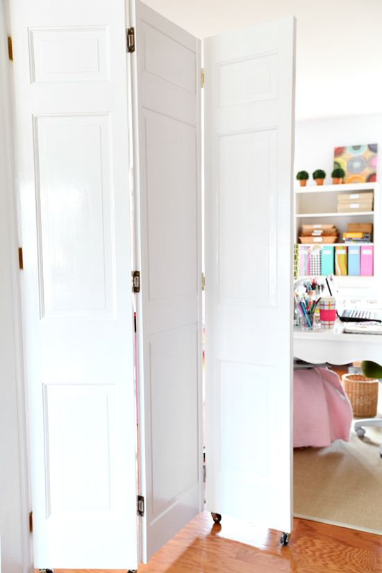 DIY-Rolling-Door-Tutorial-for-bifold-doors...Since the room is usually in a state of disarray, I created a rolling door for the doorway between the family room to hide the mess.   I found the doors at my local Habitat for Humanity store for a few dollars a piece.