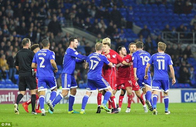 Lee Tomlin's long range effort halved the scoreline but also caused tempers to flare