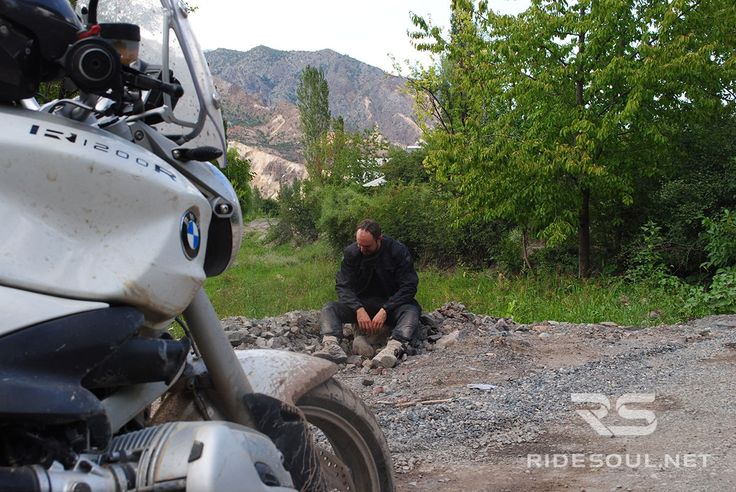 Taking a rest from 100km of riding on a muddy and dirty path in the middle of nowhere!