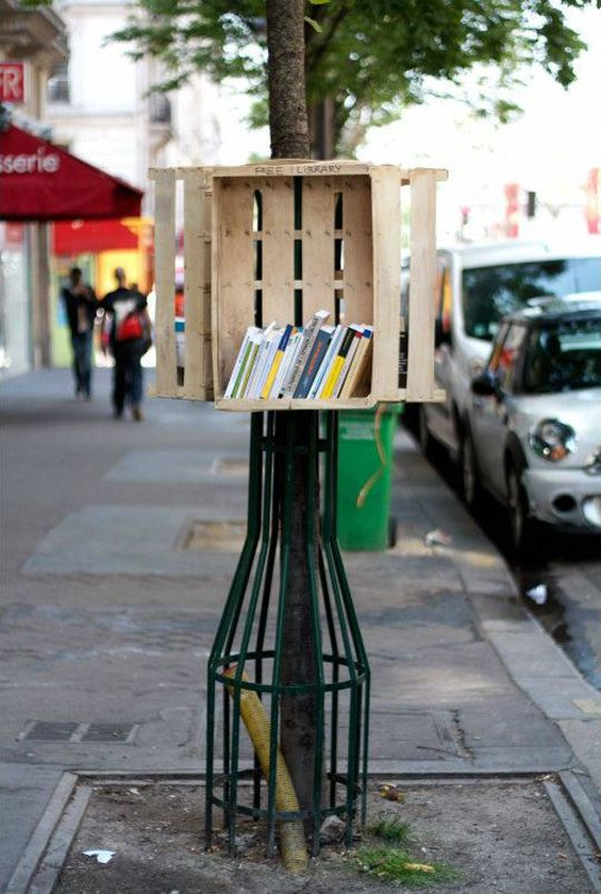 Urban Hacktivist Launches Street Library  BY JEROEN BEEKMANS  Strasbourg-based street artist Florian Rivière is back with a new, neat urban intervention! Last weekend, Rivière installed a little library on a sidewalk near Gare du Nord in Paris.  The only ingredients Rivière used for his intervention are a tree cage and a wooden crate.