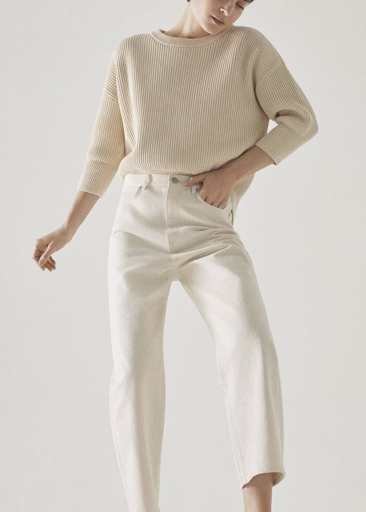 Great mix of neutral sweater with high waist white pants!
