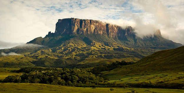 Mount Roraima in Venezuela, Brazil, and Guyana. The incredible tabletop mountains are some of the oldest geological formations on the planet, dating back about 2 billion years ago. This was also part of the inspiration for Paradise Falls in Disney's UP.