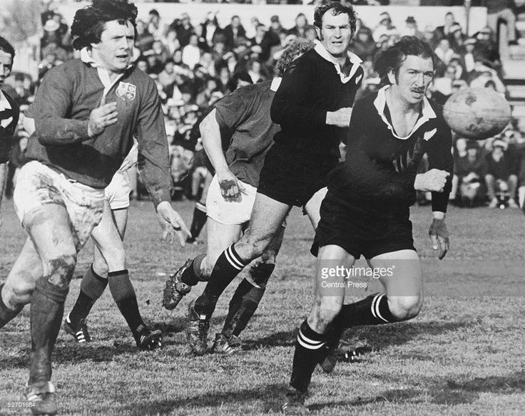 Brynmor Williams of the British Lions passes the ball as New Zealand Captain Tane Norton and Ian Kirkpatrick (centre)close in, during the second rugby test match at Christchurch, New Zealand, 15th July 1977. The British Lions won the match 13-6.