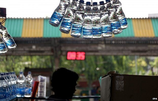 An Indian vendor sells drinking water at a railway platform while the temperatures reached 40 degree Celsius in Calcutta