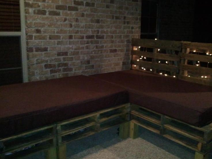 cuuute!!  for my back patio - sod pallets, made the legs from a 4' by 4', attached with screws, painted on an all in one stain/water sealant; Cushions are two twin mattresses with vinyl zipper bed protectors (to keep dry) then covered with an outdoor futon zip cover from futoncreations.com. just need to add some outdoor pillows