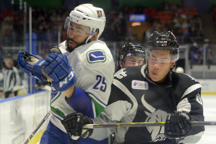 Tina Russell / Observer-Dispatch From left, Utica Comets player Darren Archibald is slammed to the wall by San Antonio Rampage player Jonathan Racine during AHL hockey at the Utica Memorial Auditorium Thursday, Jan. 1, 2015.  Read more: http://www.uticaod.com/apps/pbcs.dll/gallery?Site=NY&Date=20150101&Category=PHOTOGALLERY&ArtNo=101009998&Ref=PH&taxoid=#ixzz3NdbKtZfb