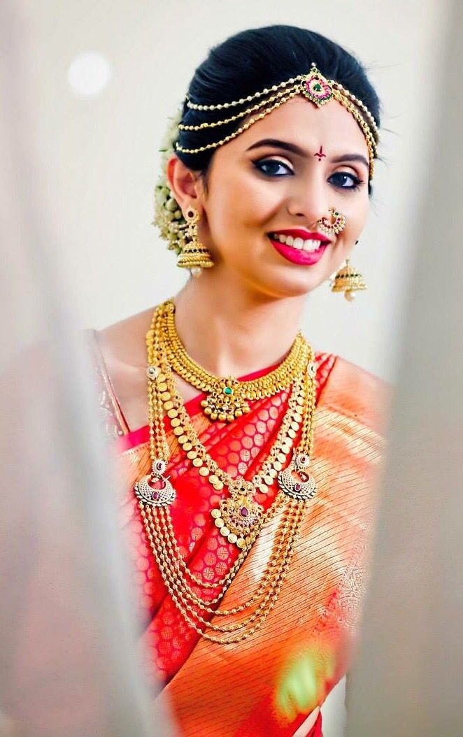 South Indian bride. Gold Temple jewelry. Jhumkis.Traditional red and gold silk kanchipuram sarees.Braid with fresh jasmine flowers. Tamil bride. Telugu bride. Kannada bride. Hindu bride. Malayalee bride.Kerala bride.South Indian wedding.