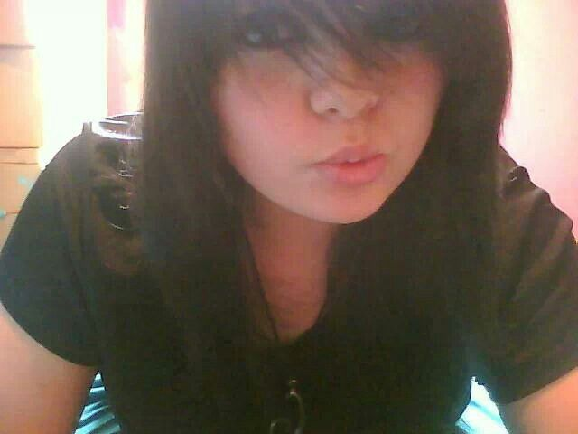 Black long bangs in the face