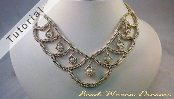 Create an elegant necklace with loops of chain using tubular herringbone.  This pattern contains 10 pages of instructions in pdf with full-color illustrations to guide you along. This design is intermediate-advanced. Youll need to be proficient in flat herringbone, and tubular herringbone. Ive made a video to show you how to make the Teardrop Bezeled Pearls. Its on the second page under the section Bezeled Pearls. You can click that link within the pdf and it will take you to the video…