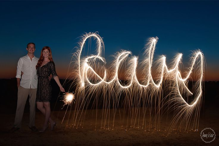 4th of July baby announcement! Sparkler photography! We used neon fountain sparklers to get the streamer effect. Copyright Rusty Gate Photography-Phoenix, Arizona