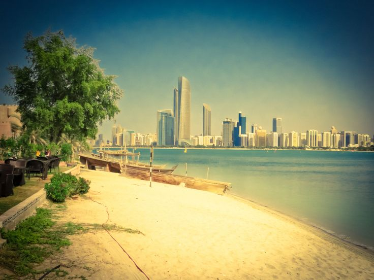 View over the city's modern buildings from the beach near the Heritage Village in Abu Dhabi, United Arab Emirates.