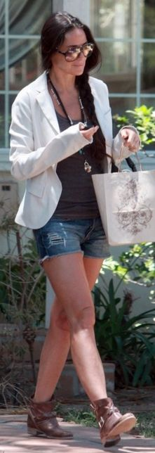 Who made  Demi Moore's brown braided boots and blue denim cut off shorts?