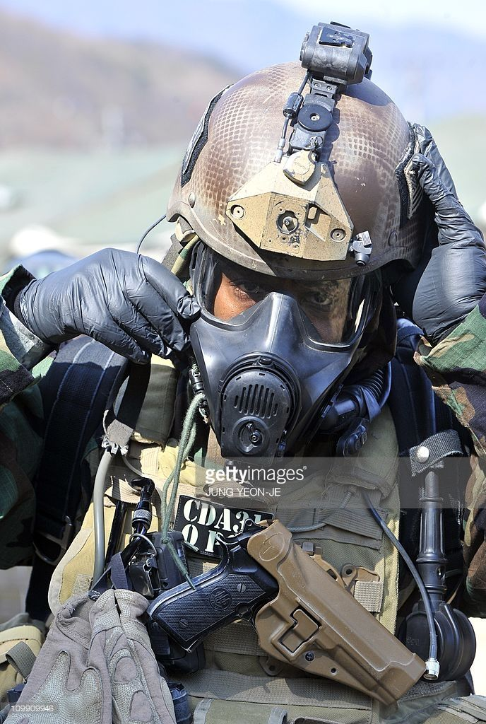 A US soldier wears chemical warfare gear during a joint military exercise with South Korea at a US Army base in Dongducheon, 40kms north of Seoul, on March 3, 2011 aimed to simulate the detection and disposal of North Korea's chemical, biological, radiological and nuclear weapons. US and South Korean soldiers displayed their techniques for handling weapons of mass destruction (WMD) in the face of North Korea's nuclear sabre-rattling.