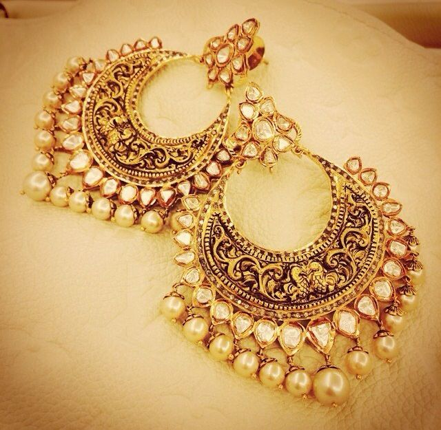 Gold and pearl hoop earrings. Indian fashion.
