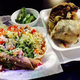 Photo of Lucha Libre Gourmet Taco Shop - San Diego, CA, United States. Surf and turf burrito, taquitos