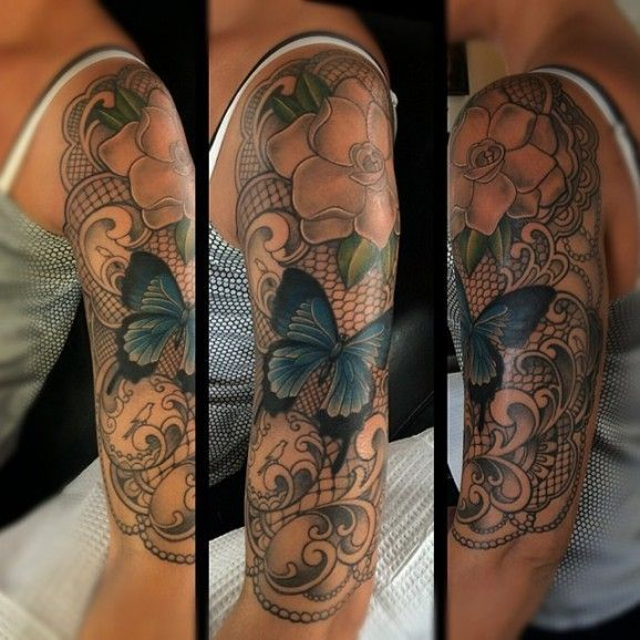 Half sleeve with flowers and butterfly by Laura Jade.