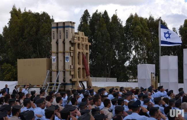 Israeli Air Force soldiers salute the Israeli flag at the official launch ceremony of the David's Sling Air Defense System at the Hatzor…