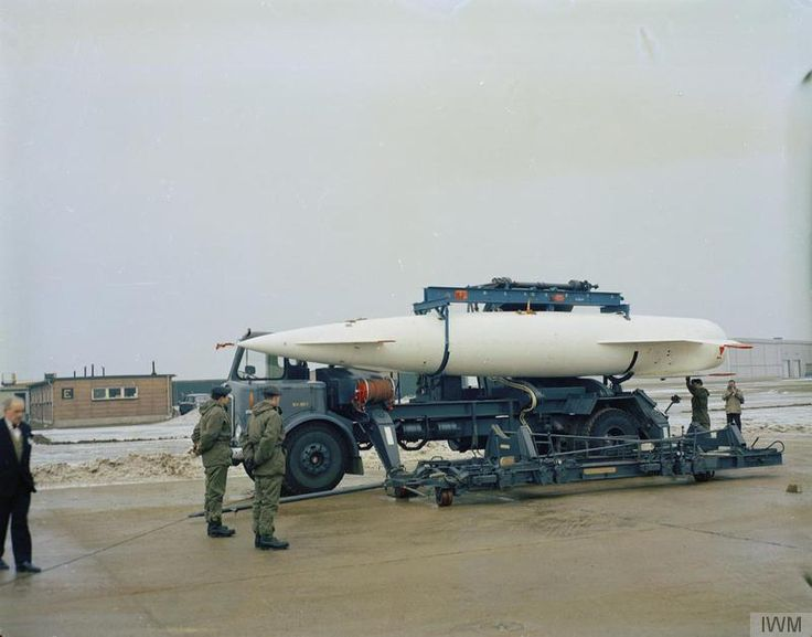 Lowering the Avro Blue Steel stand-off nuclear bomb from its conveyor vehicle to an awaiting 'dolly' to take the bomb to the Avro Vulcan B.2A. RAF Scampton, Lincolnshire, home of No 617 Squadron.