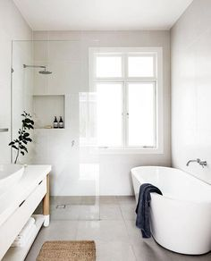 This bathroom layout is for all the chips on the table. The large format tile makes it muted and calm to the eye, the glass divider maintains an open feel, and the hints of wood and nature bring life to the space. Royal flush, ladies and gents.