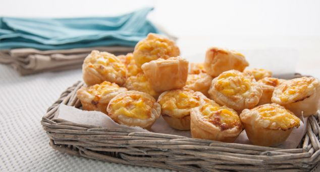 The perfect bite sized snack! Make up a big batch of these mini cheese and bacon quiches and freeze for later.