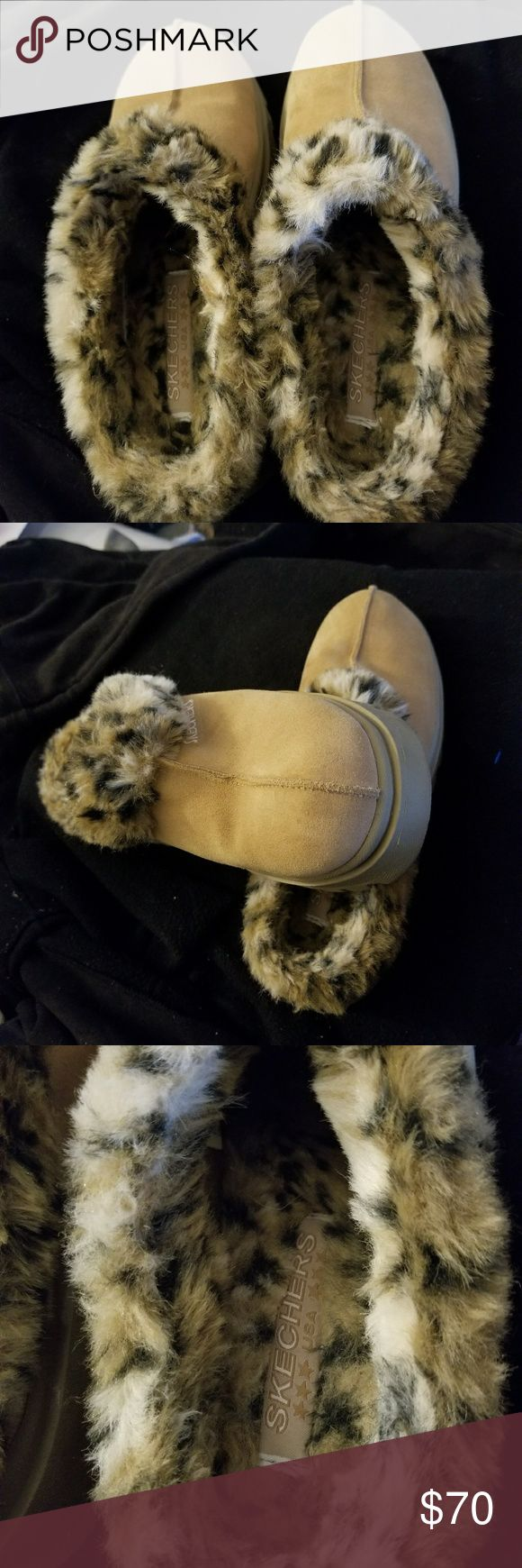 NWOT SKECHERS SLIP ON SHOES SKECHERS FAUX FUR LEOPARD SLIP ON SHOES VERY WARM AND COMFORTABLE  BOUGHT WORN ONCE TO TIGHT FOR ME MY LOSS YOUR GAIN VERY BEAUTIFUL NO SCUFFS RIPS TEARS OR STAINS SIZE 9       9/10 sketchers Shoes Flats & Loafers