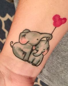 Baby elephants tattoo in honor of my sons.     Family Mickey Mouse Disney balloon elephant ink children kids