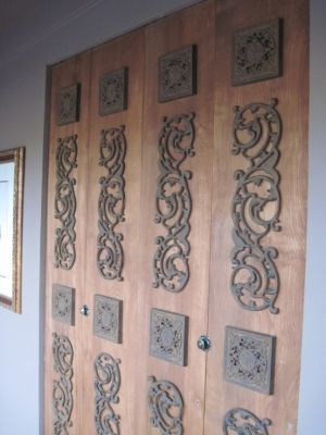 way to disguise ugly doors.  cheap pieces from old time pottery by Sister's Vintage