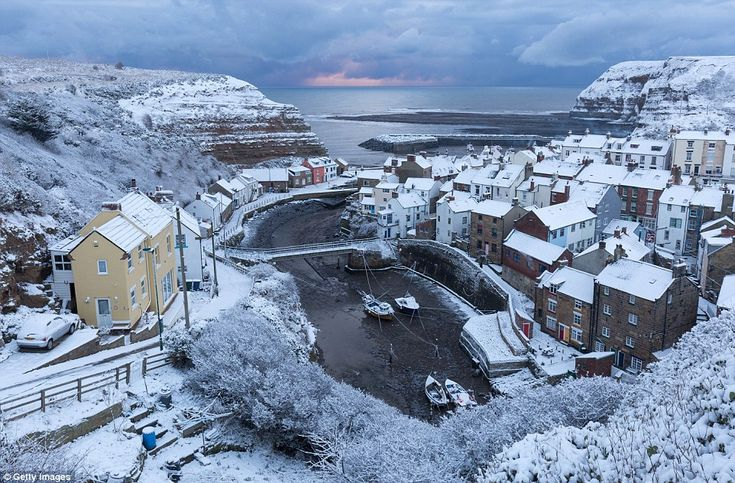 "Snow covers the Yorkshire Coast at Staithes today as the freezing weather conditions arrive across eastern parts of UK | ""Red sky at morning, sailor's warning"" North Sea coastal geological strata backdrop to picturesque tiny homes https://www.loc.gov/rr/scitech/mysteries/weather-sailor.html"