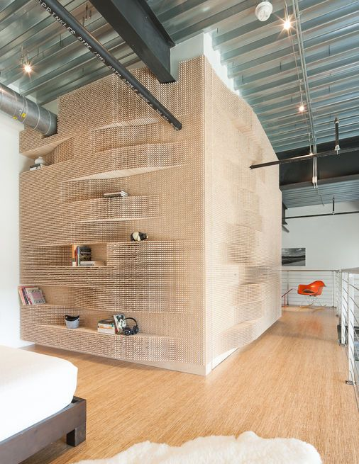 Sometimes, pegboard can work as an architectural canvas, like in the case of this Massachusetts loft. For the bookshelf—essentially an oversized pegboard wall that wraps around a bathroom—Merge Architects blended handcraftsmanship and digital tooling by crafting a three-dimensional, undulating pattern across the surface of the volume by sticking in dowels.  Photo by: John Horner