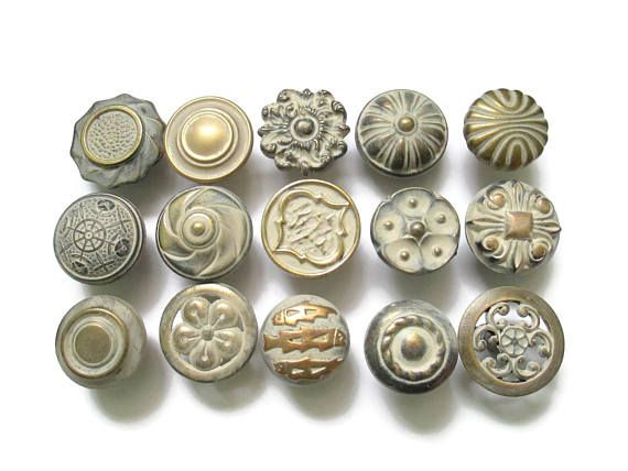 this listing is for a lot of 15 different vintage drawer knobs 1 or 2 might be slightly newer with all 15 screws all refinished in creambrass