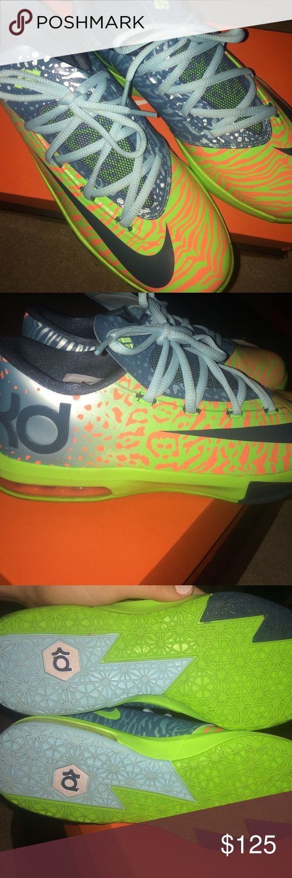 Nike KD VI Liger sneakers size 5y / 7.5 womens Neon green and orange sneakers with tiger stripes and leopard print. Comes with light blue laces. Great condition. First photo is for reference Nike Shoes Sneakers